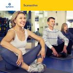 ludzie siedzący na podłodze na siłowni